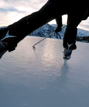 Vancouver Canucks players lace up for frozen lake game of shinny in the mountains.