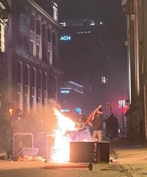 Montreal businesses clean up after anti-curfew protest turns violent.